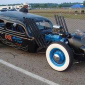 Rat Rod with extreme header pipes and a wicked racked grill.