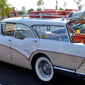 1957 Buick with wire wheels.