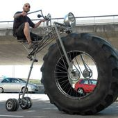 It is three-wheeled vehicle with a monster tyre up front and it is human powered.
